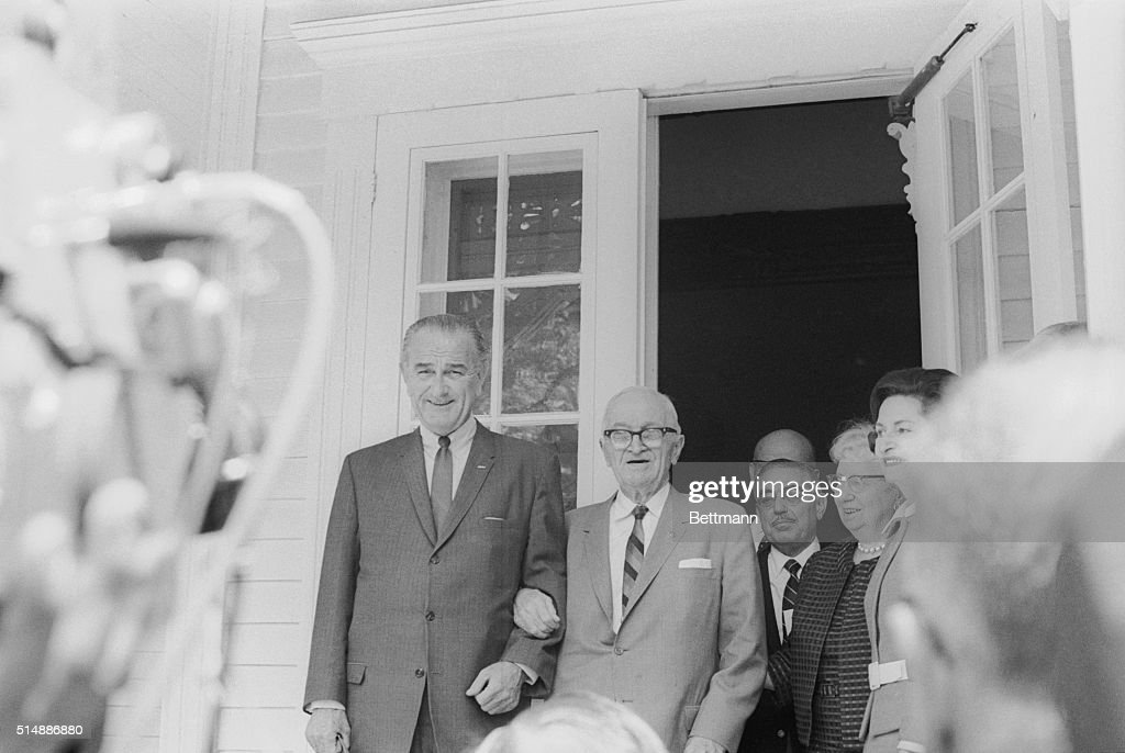 President <a gi-track='captionPersonalityLinkClicked' href=/galleries/search?phrase=Lyndon+Johnson&family=editorial&specificpeople=91450 ng-click='$event.stopPropagation()'>Lyndon Johnson</a> and former President <a gi-track='captionPersonalityLinkClicked' href=/galleries/search?phrase=Harry+Truman&family=editorial&specificpeople=91039 ng-click='$event.stopPropagation()'>Harry Truman</a> stand arm-in-arm on the porch of Truman's house after Johnson visited with Truman. Johnson reported to Truman the developments in the proposed Vietnam peace talks.