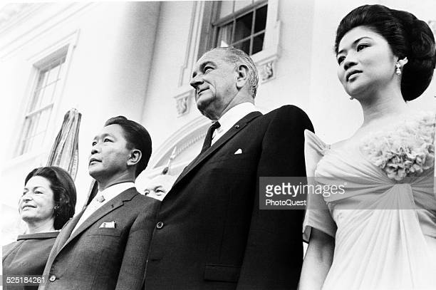 US President Lyndon Johnson and his wife First Lady Ladybird Johnson pose with Philippine President Ferdinand Marcos and his wife Imelda Marcos...