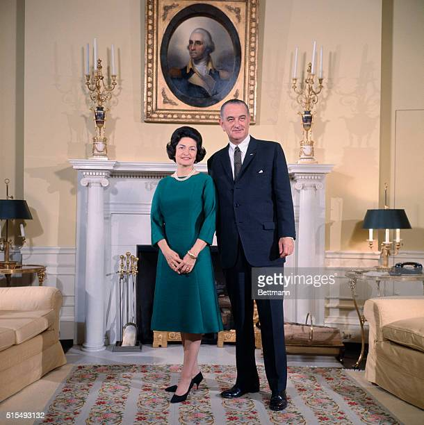 President Lyndon Johnson and Lady Bird Johnson stand in the Yellow Oval Room of the White House for a preinauguration photograph
