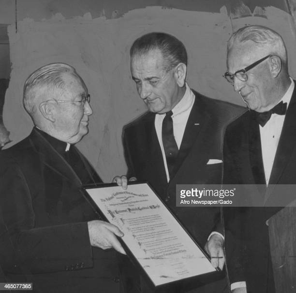 President Lyndon Johnson and United States Supreme Court Chief Justice Carl Warren present an award for improving racial understanding to Patrick...