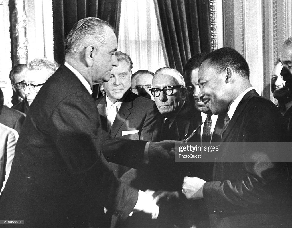 President <a gi-track='captionPersonalityLinkClicked' href=/galleries/search?phrase=Lyndon+Johnson&family=editorial&specificpeople=91450 ng-click='$event.stopPropagation()'>Lyndon Johnson</a> hands a souvenir pen to the Reverend Martin Luther King Jr after signing the Voting Rights Bill at the US Capital, Washington DC, 1965.