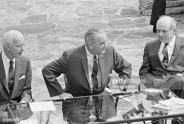 President Lyndon Johnson meets with his top advisors at Camp David to discuss the Vietnam War Seated at the table are Ambassador to Vietnam Ellsworth...