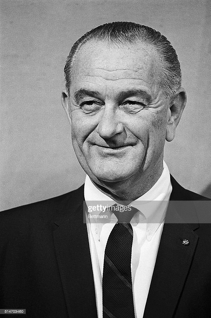 President Lyndon Johnson smiles during a White House ceremony at which he presented Young America medals for bravery and service.