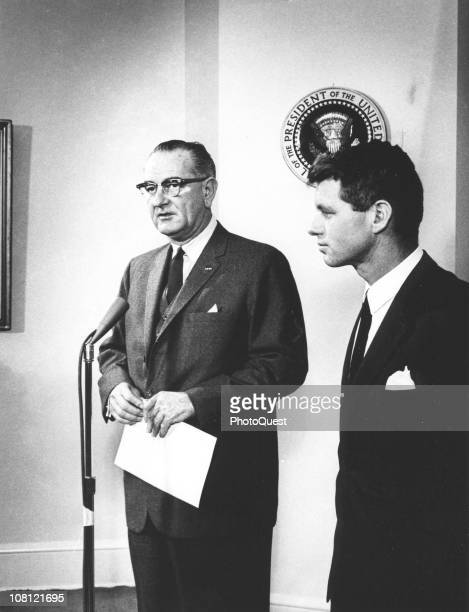 US President Lyndon Johnson speaks into a microphone about United States Attorney General Robert F Kennedy who had just returned from a tour of South...
