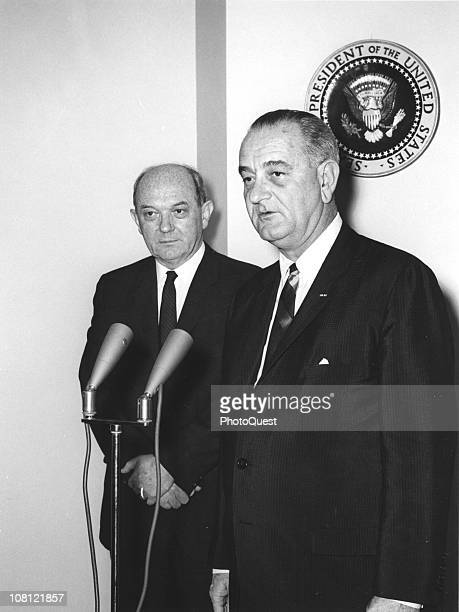 US President Lyndon Johnson speaks into a microphone upon his return from a tour of Vietnam as Secretary of State Dean Rusk stands nearby Washington...