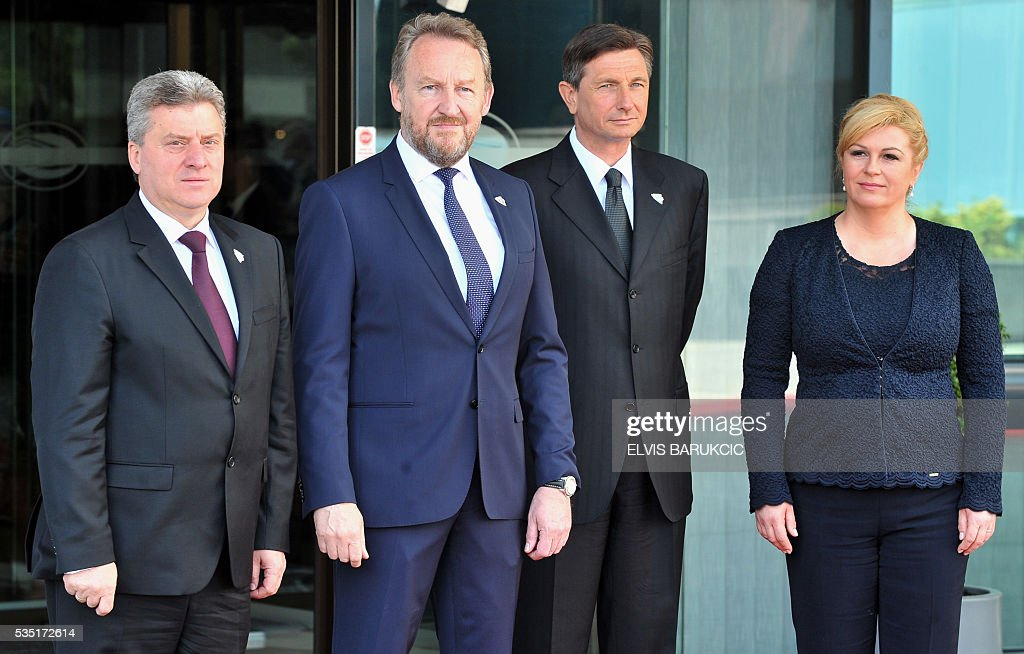President Macedonia Gjorge Ivanov, Member of the Tripartite Bosnian Presidency Bakir Izetbegovic, President of Slovenia Borut Pahor, Croatian President Kolinda Grabar-Kitarovic pose at Bosnia and Herzegovina's National Assembly in Sarajevo, on May 29, 2016. Heads of western Balkan nations meet for an annual summit during which they will discuss regional cooperation. / AFP / ELVIS