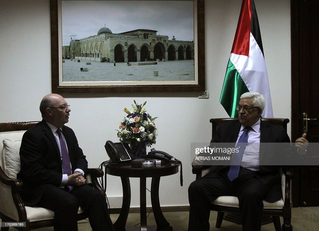 President Mahmud Abbas (R) meets with British Foreign Office Minister for the Middle East Alistair Burt, on June 12, 2013, in the West Bank city Ramallah.