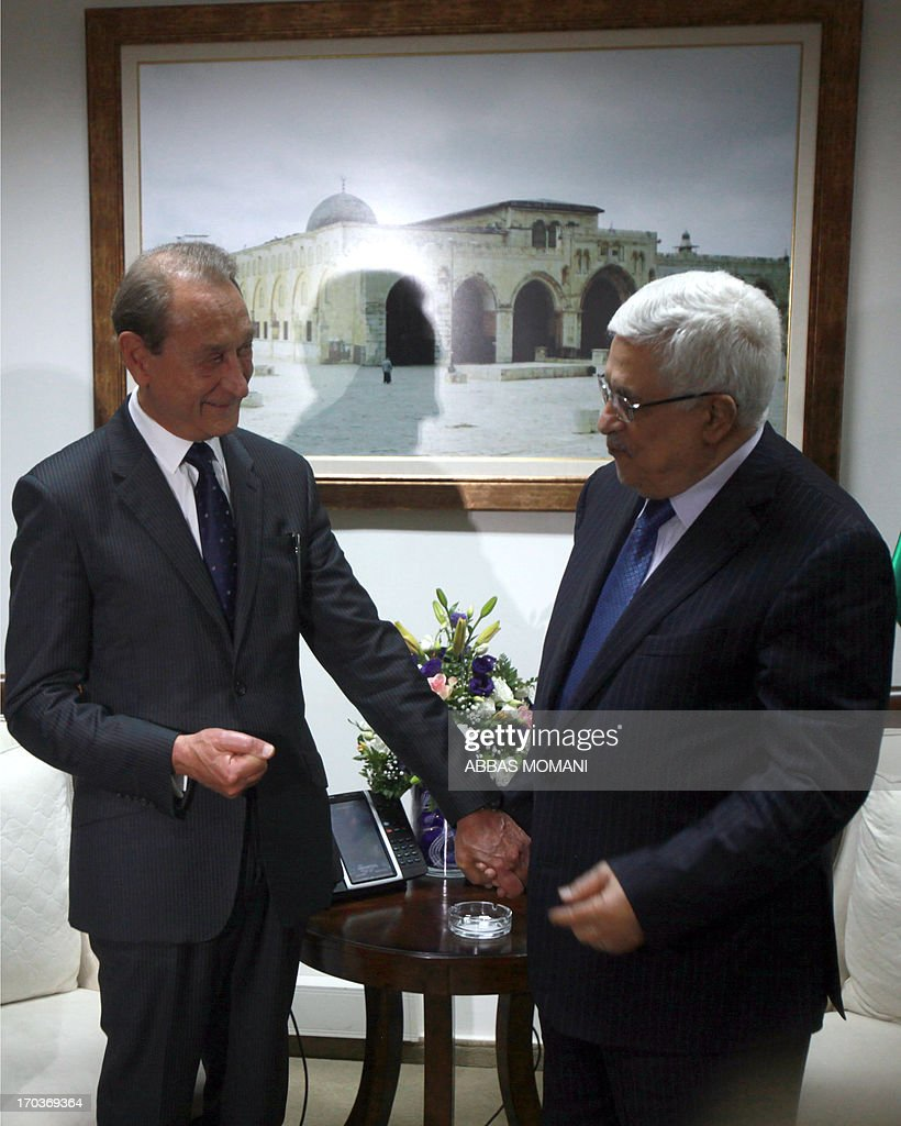 President Mahmud Abbas receives the Mayor of Paris Bertrand Delanoë (L) in the West Bank city of Ramallah on June 12, 2013, where he conferred on him an honorary Palestinian citizenship.