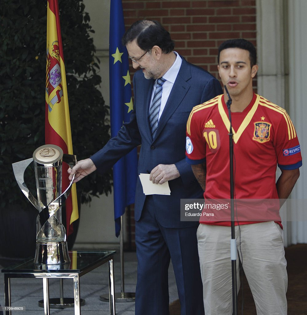 President Mariano Rajoy (L) and soccer player Thiago Alcantara attend winners of U21 cup reception at Moncloa Palace on June 20, 2013 in Madrid, Spain.