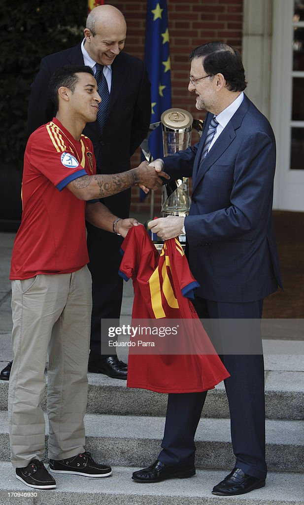 President Mariano Rajoy (R) and soccer player Thiago Alcantara attend winners of U21 cup reception at Moncloa Palace on June 20, 2013 in Madrid, Spain.