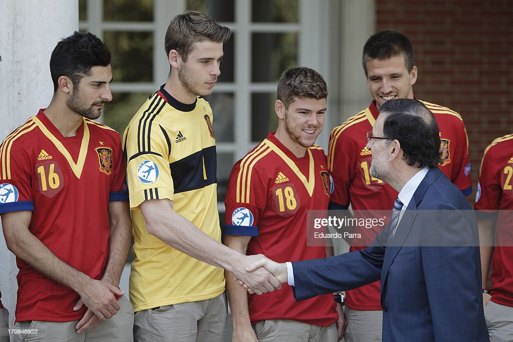 President Mariano Rajoy (R) greets soccer player <a gi-track='captionPersonalityLinkClicked' href=/galleries/search?phrase=David+de+Gea&family=editorial&specificpeople=3000749 ng-click='$event.stopPropagation()'>David de Gea</a> at winners of U21 cup reception at Moncloa Palace on June 20, 2013 in Madrid, Spain.
