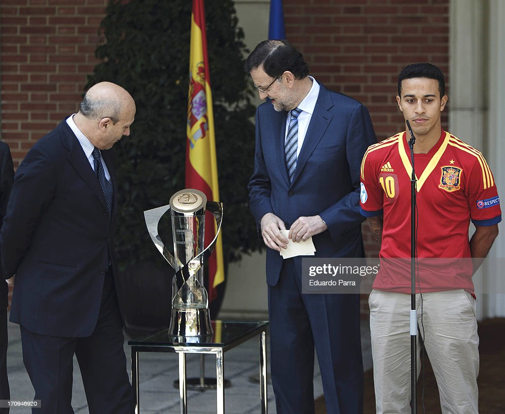 President Mariano Rajoy (C), soccer player Thiago Alcantara (L) and Minister of Culture Jose Ignacio Wert attend winners of U21 cup reception at Moncloa Palace on June 20, 2013 in Madrid, Spain.