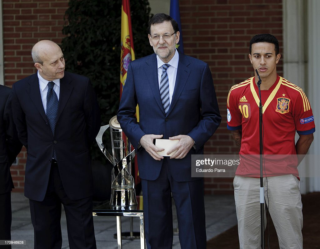 President Mariano Rajoy (C), soccer player Thiago Alcantara (L) and Minister of Culture <a gi-track='captionPersonalityLinkClicked' href=/galleries/search?phrase=Jose+Ignacio+Wert&family=editorial&specificpeople=8761709 ng-click='$event.stopPropagation()'>Jose Ignacio Wert</a> attend winners of U21 cup reception at Moncloa Palace on June 20, 2013 in Madrid, Spain.