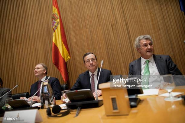 ECB President Mario Draghi and President of the Spanish Parliament Jesus Posada attends a meeting at Spain's Parliament on February 12 2013 in Madrid...