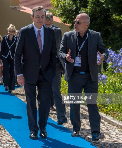 President Mario Draghi and the Governor of Bulgarian National Bank Dimitar Radev leave the conference area at the end of the last discussion session...