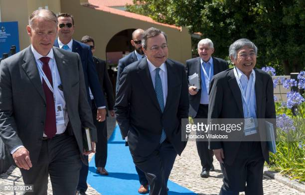 President Mario Draghi and the Governor of the Bank of Japan Haruhiko Kuroda share a laugh while leaving the conference area at the end of the first...