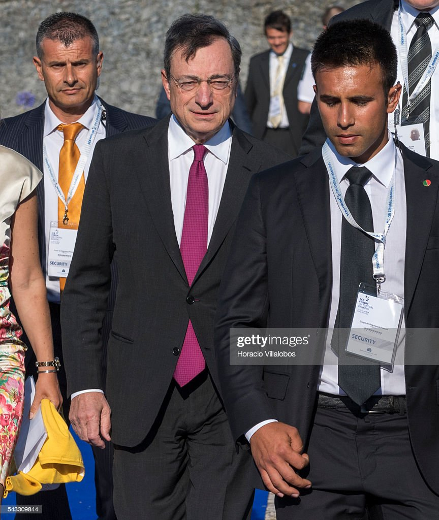 President Mario Draghi (C) arrives accompanied of ECB Director General Communications Christine Graeff (not seen) and flanked by security guards to participate in the ECB Forum on Central Banking on June 27, 2016 in Sintra, Portugal. The third annual European Central Bank Forum on Central Banking focuses on 'The future of the international monetary and financial architecture', a key topic of debate among economists and policymakers. Some 150 central bank governors, academics, financial journalists and high-level financial market representatives will discuss current policy issues and the chosen topic from a longer-term perspective.