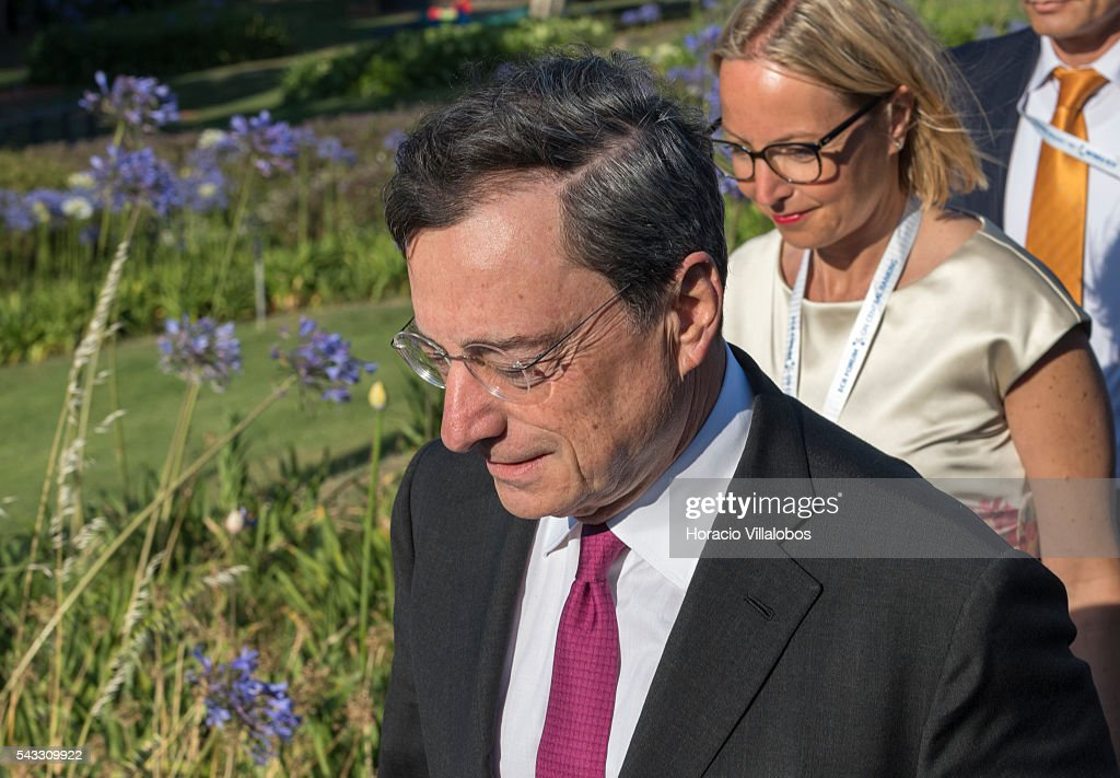 President Mario Draghi (C) arrives accompanied of ECB Director General Communications Christine Graeff (R) to participate in the ECB Forum on Central Banking on June 27, 2016 in Sintra, Portugal. The third annual European Central Bank Forum on Central Banking focuses on 'The future of the international monetary and financial architecture', a key topic of debate among economists and policymakers. Some 150 central bank governors, academics, financial journalists and high-level financial market representatives will discuss current policy issues and the chosen topic from a longer-term perspective.