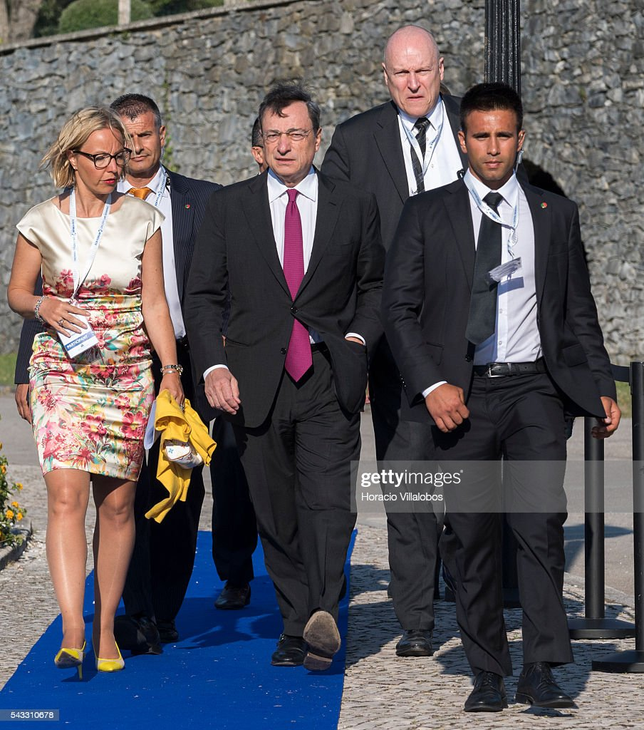 President Mario Draghi (C) arrives accompanied of ECB Director General Communications Christine Graeff (L) and flanked by security guards to participate in the ECB Forum on Central Banking on June 27, 2016 in Sintra, Portugal. The third annual European Central Bank Forum on Central Banking focuses on 'The future of the international monetary and financial architecture', a key topic of debate among economists and policymakers. Some 150 central bank governors, academics, financial journalists and high-level financial market representatives will discuss current policy issues and the chosen topic from a longer-term perspective.