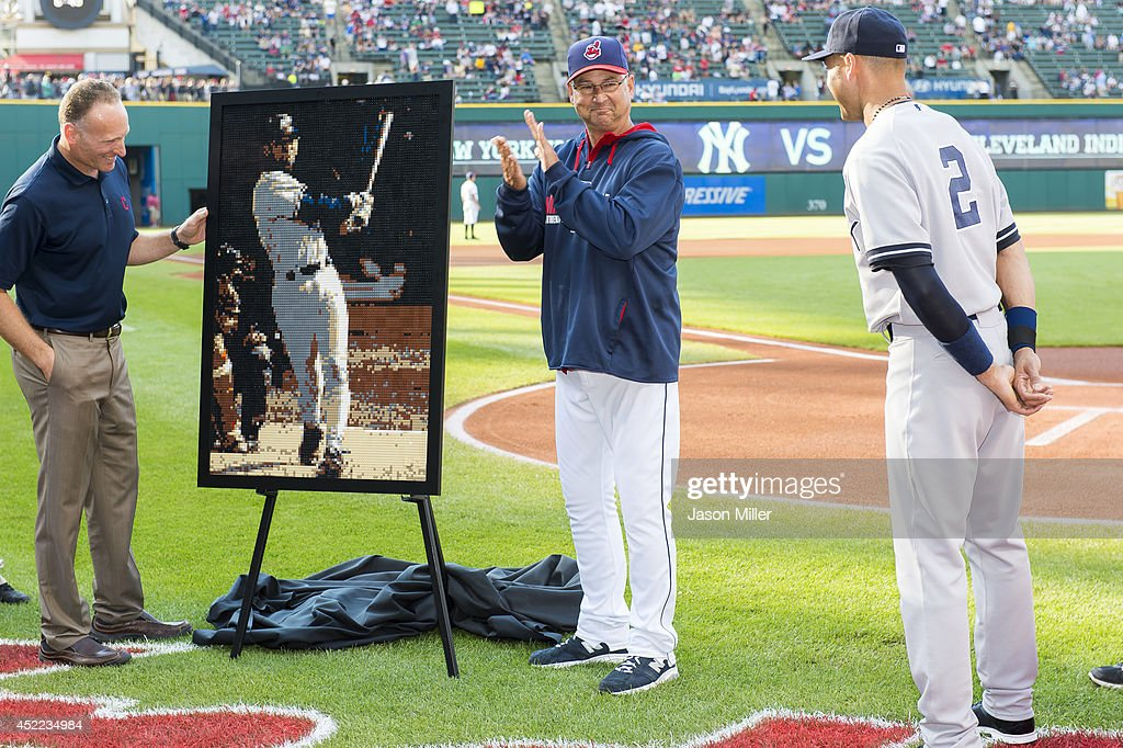 President Mark Shapiro, left, and Manager Terry Francona #17 of the Cleveland Indians, center, present Derek Jeter #2 of the New York Yankees, right, with a Lego sculpture created by Indians staff depicting Jeter's first major league home run at Progressive Field on July 10, 2014 in Cleveland, Ohio. The sculpture was presented during a ceremony prior to the game honoring Jeter prior to his retirement at the end of the 2014 season.