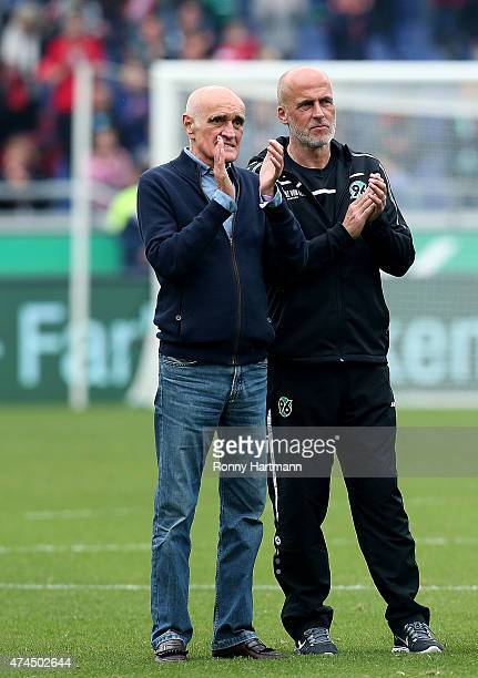 President Martin Kind and head coach Michael Frontzeck of Hannover applauds the fans after the Bundesliga match between Hannover 96 and SC Freiburg...