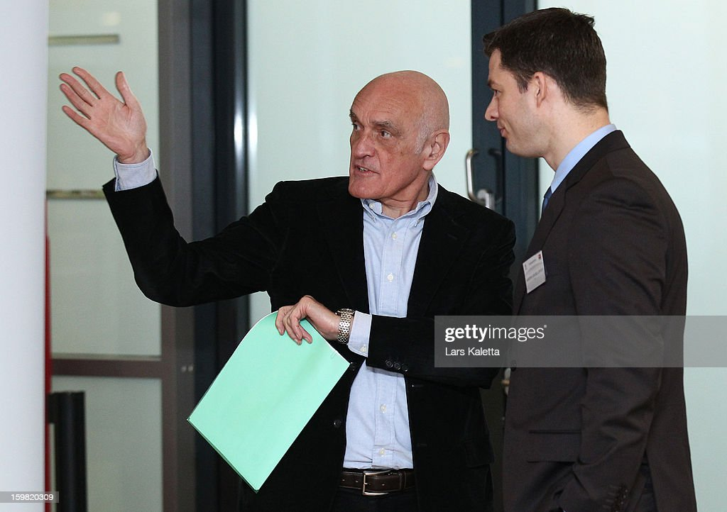 President Martin Kind (L) of Hannover 96 speaks to Hendrik Grosse Lefert (R), Security Chief of the German Football Association DFB during the DFB & DFL regional conference at AWD Arena on January 21, 2013 in Hanover, Germany.
