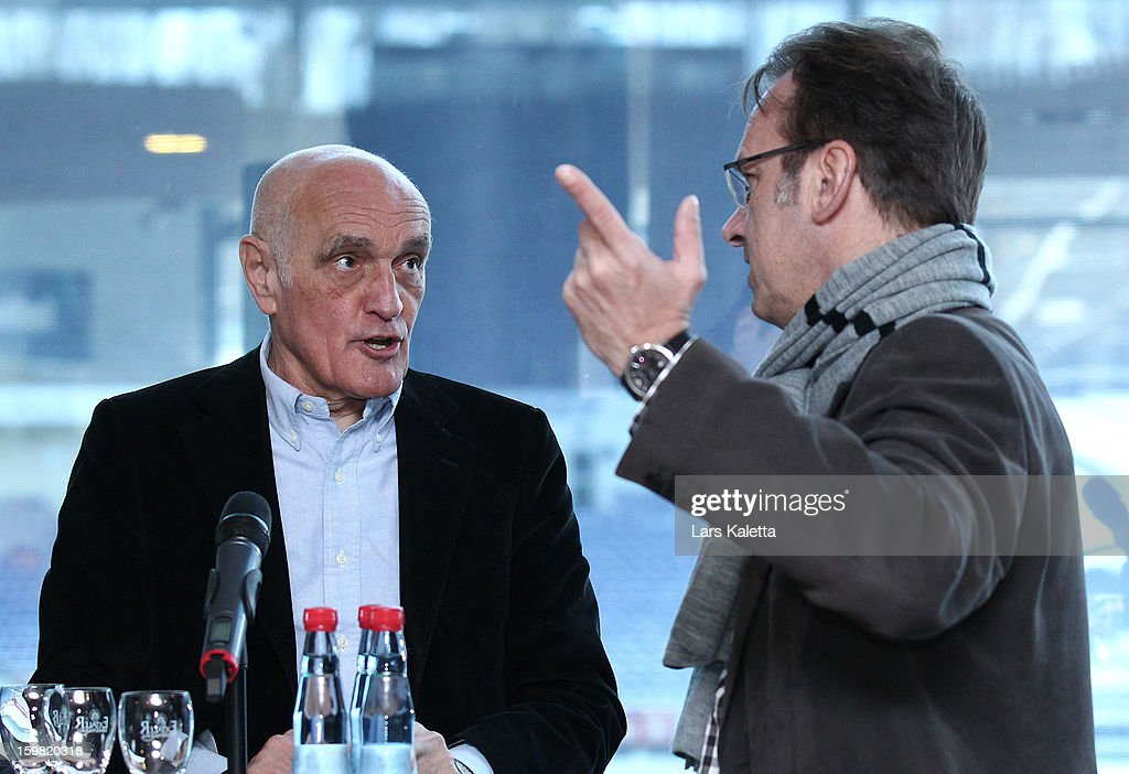 President Martin Kind (L) of Hannover 96 speaks to Thomas Schneider (R) of German Football League (DFL) during the DFB & DFL regional conference at AWD Arena on January 21, 2013 in Hanover, Germany.