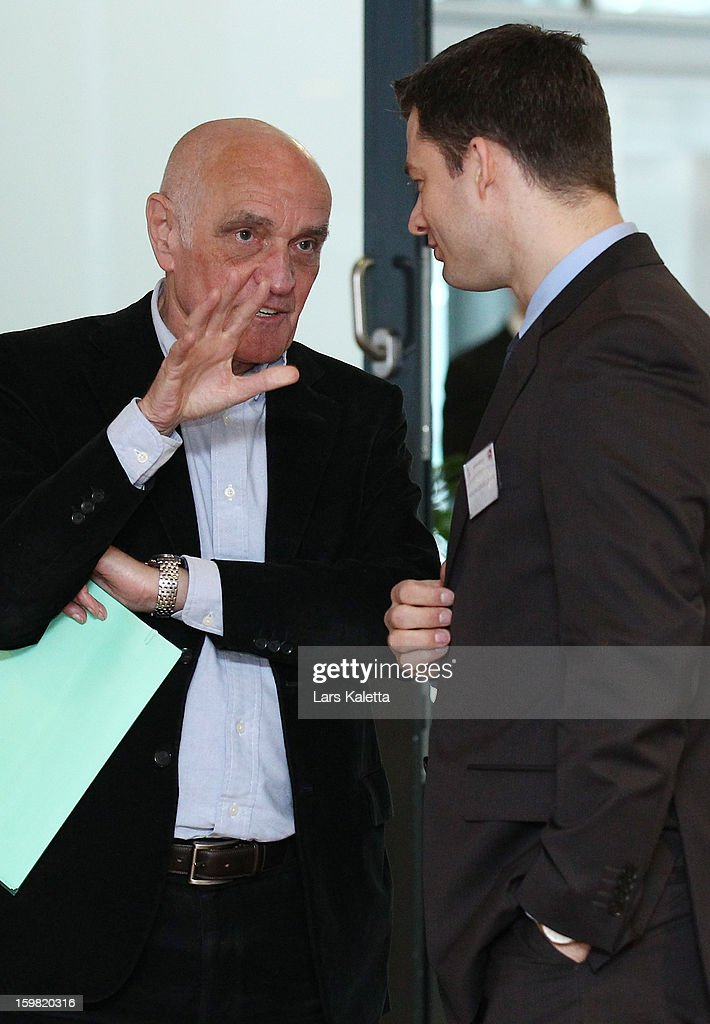 President Martin Kind (L) of Hannover 96 talks with Hendrik Grosse Lefert (R), Security Chief of the German Football Association DFB, during the DFB & DFL regional conference at AWD Arena on January 21, 2013 in Hanover, Germany.