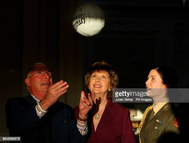 President Mary McAleese is presented with a signed team football by the Captain of the Down 1968 AllIreland Football Team Joe Lennon at Aras an...