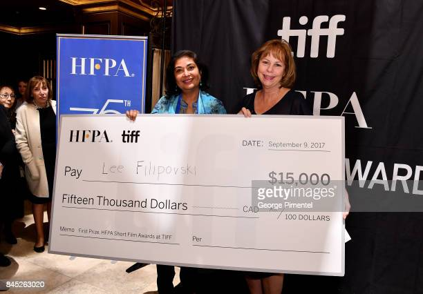 President Meher Tatna and TIFF Executive Director and COO Michele Maheux present the firstever 'HFPA TIFF Short Film Award' at The Hollywood Foreign...