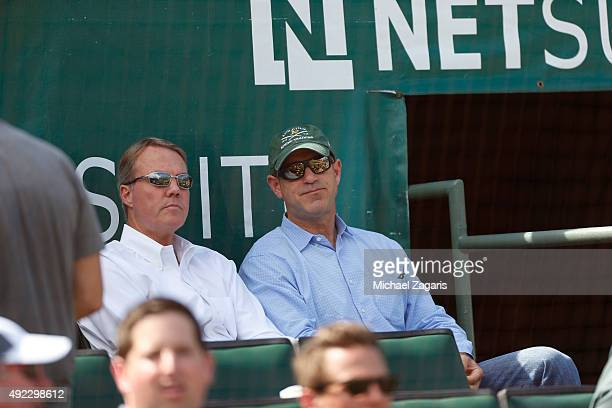 President Michael Crowley and Owner John Fisher of the Oakland Athletics sit in the stands during the game against the Texas Rangers at Oco Coliseum...