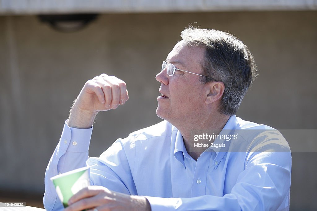 President Michael Crowley of the Oakland Athletics stands in the dugout during a spring training workout at Phoenix Municipal Stadium on February 28, 2013 in Phoenix, Arizona.