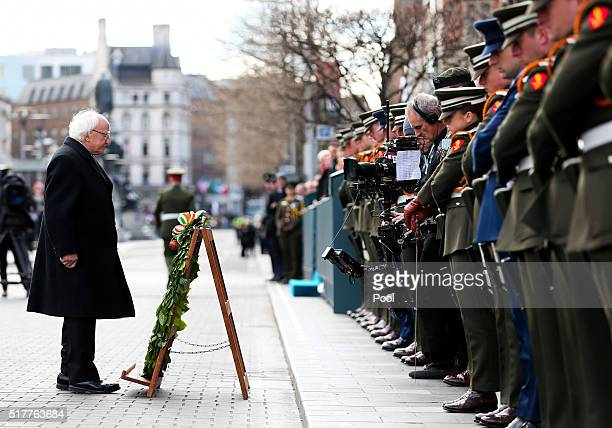 President Michael D Higgins lays a wreath during the Easter Sunday Commemoration Ceremony at the General Post Office on March 27 2016 in Dublin...