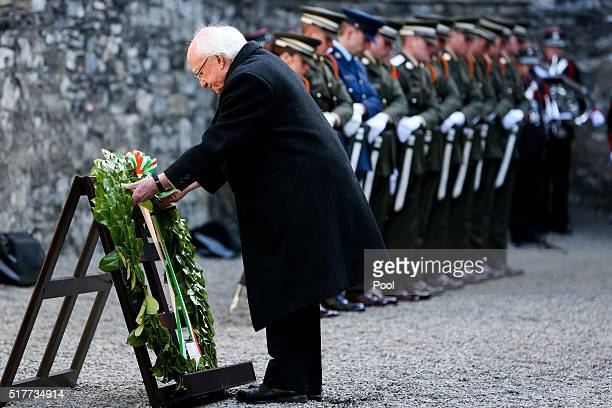 President Michael D Higgins lays a wreath on the site where the 1916 leaders were executed at the Easter Sunday Wreathlaying ceremony in Kilmanham...