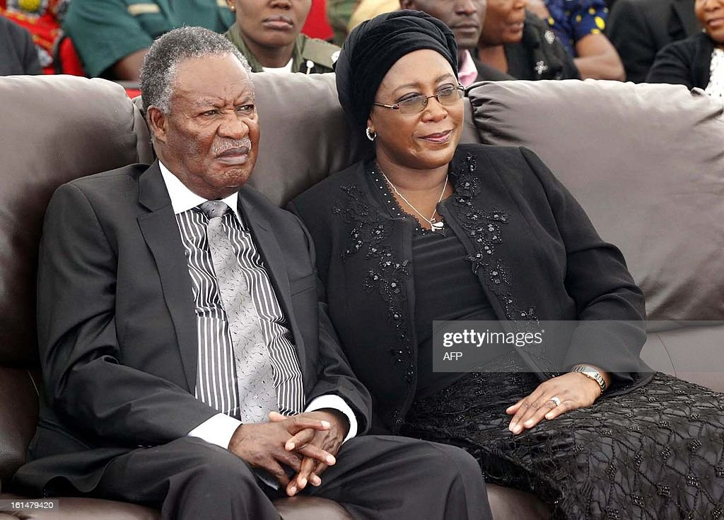 President <a gi-track='captionPersonalityLinkClicked' href=/galleries/search?phrase=Michael+Sata&family=editorial&specificpeople=1944545 ng-click='$event.stopPropagation()'>Michael Sata</a> (L) and his wife, Dr Christine Kaseba, attend the the burial on February 11, 2013 at Mutengo Cemetery in Ndola, of the Chibombo accident victims. A Zambia bus carrying 74 passengers collided head-on with a heavy goods truck on February 7, near Lusaka killing 53 passengers on board. President Sata declared three days of national mourning for the victims. AFP PHOTO / JOSEPH MWENDA