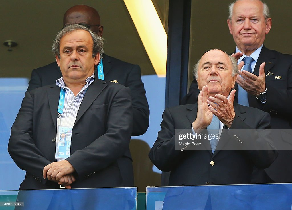 President Michel Platini (L) and FIFA President Joseph Blatter look on during the 2014 FIFA World Cup Brazil Group G match between Germany and Portugal at Arena Fonte Nova on June 16, 2014 in Salvador, Brazil.