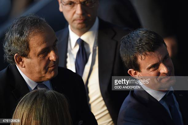 President Michel Platini and French Prime Minister Manuel Valls are seen prior to the UEFA Champions League Final football match between Juventus and...