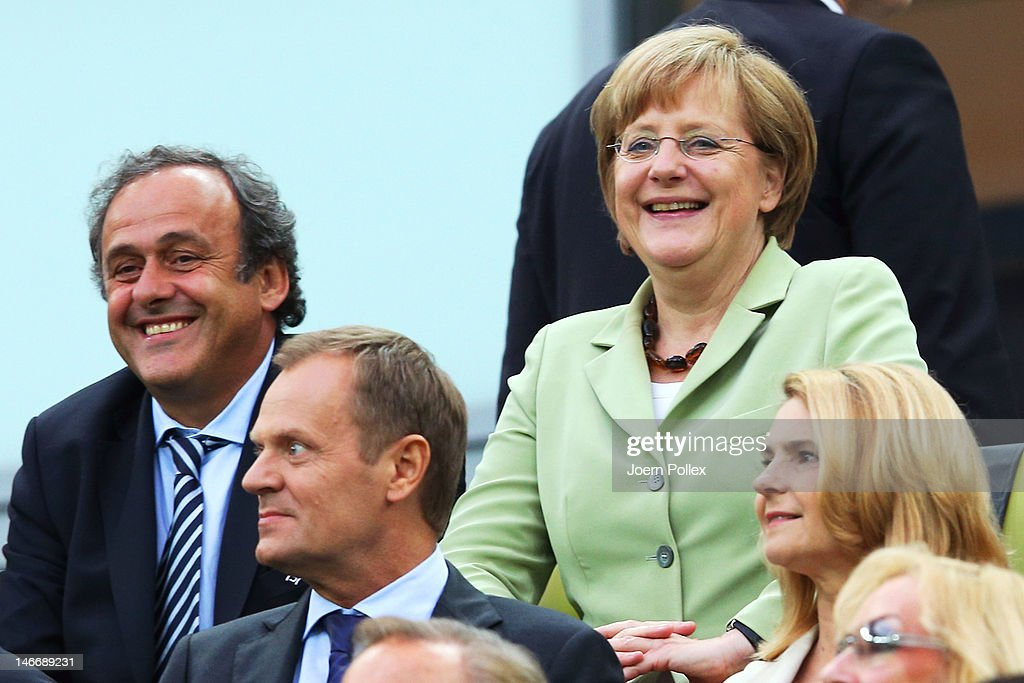 President <a gi-track='captionPersonalityLinkClicked' href=/galleries/search?phrase=Michel+Platini&family=editorial&specificpeople=206862 ng-click='$event.stopPropagation()'>Michel Platini</a> and German Chancellor <a gi-track='captionPersonalityLinkClicked' href=/galleries/search?phrase=Angela+Merkel&family=editorial&specificpeople=202161 ng-click='$event.stopPropagation()'>Angela Merkel</a> smile during the UEFA EURO 2012 quarter final match between Germany and Greece at The Municipal Stadium on June 22, 2012 in Gdansk, Poland.
