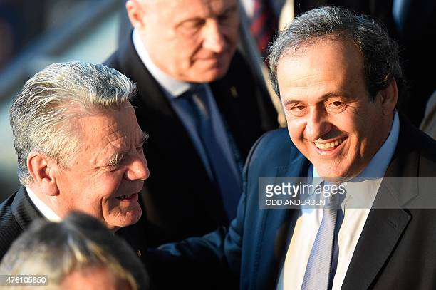 President Michel Platini and German President Joachim Gauck are seen prior to the UEFA Champions League Final football match between Juventus and FC...
