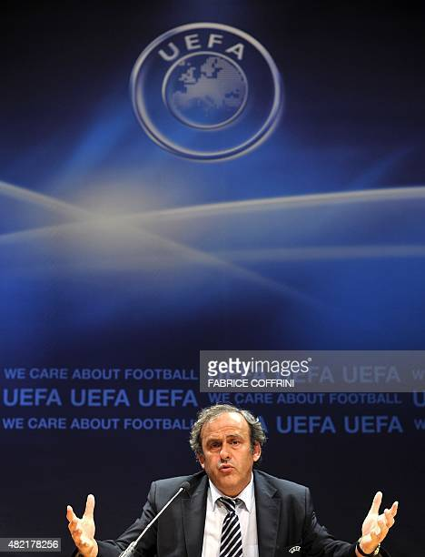 UEFA president Michel Platini gestures during a press conference following an executive board meeting at the European football's goaverning body...