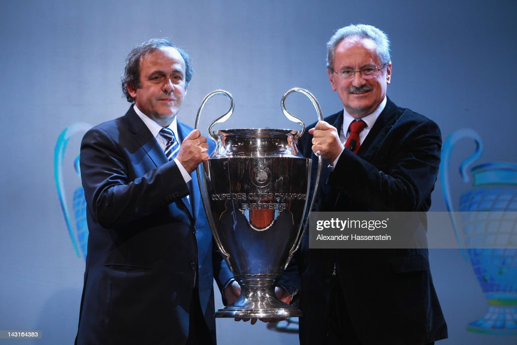 President Michel Platini (L) hands over the UEFA Champions League winners trophy to Christian Ude, Lord Mayor of Munich, during the UEFA Champions League Trophy handover at Munich town hall on April 20, 2012 in Munich, Germany.