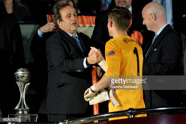 President Michel Platini honors oalkeeper Frederick Woodman of England after the UEFA Under17 European Championship 2014 final match between England...