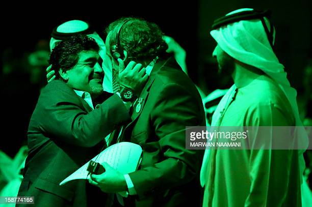 UEFA president Michel Platini hugs Argentinian football icon and former player Diego Maradona during the first session of the International Sports...