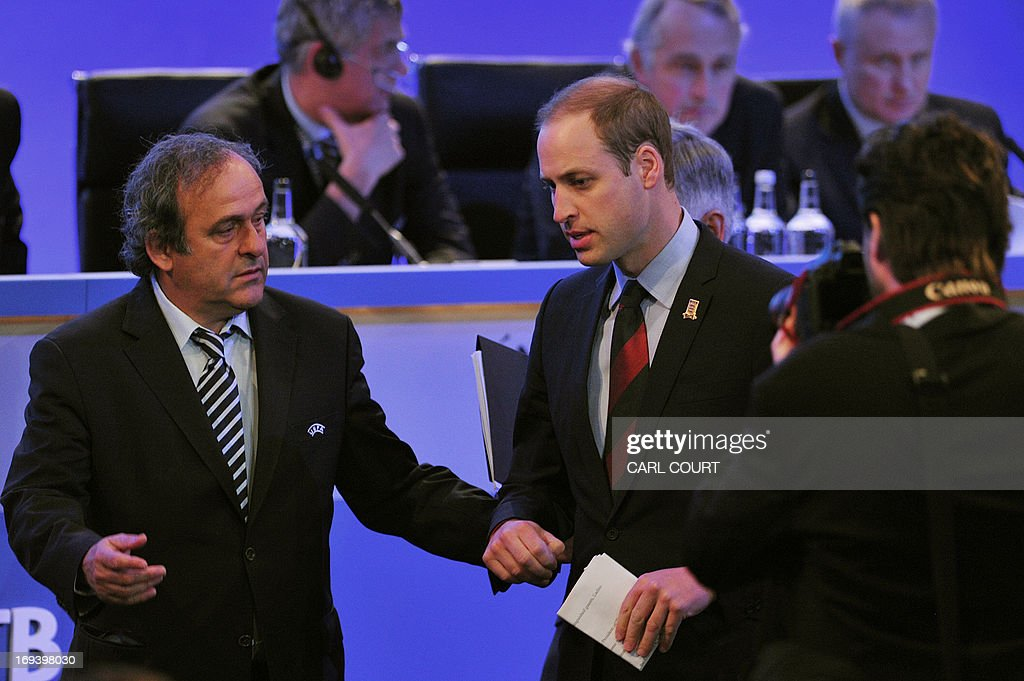 President Michel Platini (L) leads Britain's Prince William to his seat at the beginning of the UEFA Congress in central London on May 24, 2013. Speaking at the UEFA congress UEFA President Michel Platini identified the three main problems facing the game as match-fixing, discrimination and financial excesses.