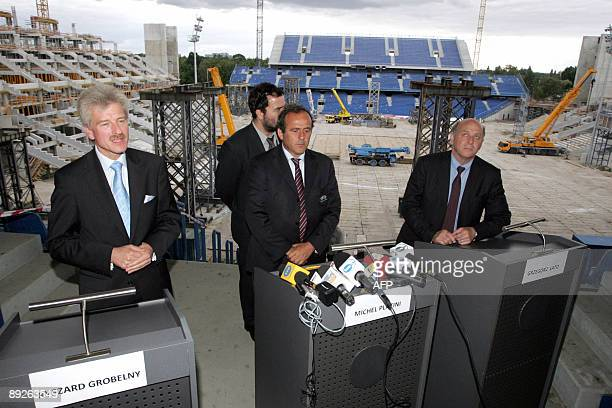 UEFA president Michel Platini president of Polish Football Association Grzegorz Lato and Mayor of Poznan Ryszard Grobelny talk with journalists after...
