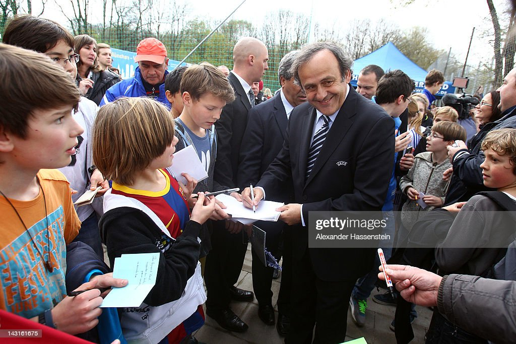 President Michel Platini signs autographs after handing over a mini-pitch to Munich, the host city of the UEFA Champions League and UEFA Women`s Champions Legaue final city on April 20, 2012 in Munich, Germany.