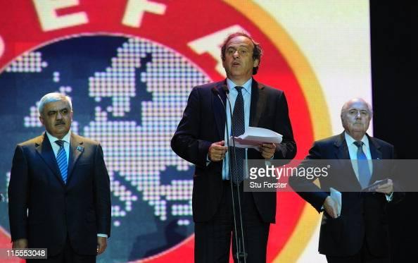 UEFA president Michel Platini speaks as FIFA president Sepp Blatter looks on during a dinner celebration to mark 100 years of Football in Azerbaijan...