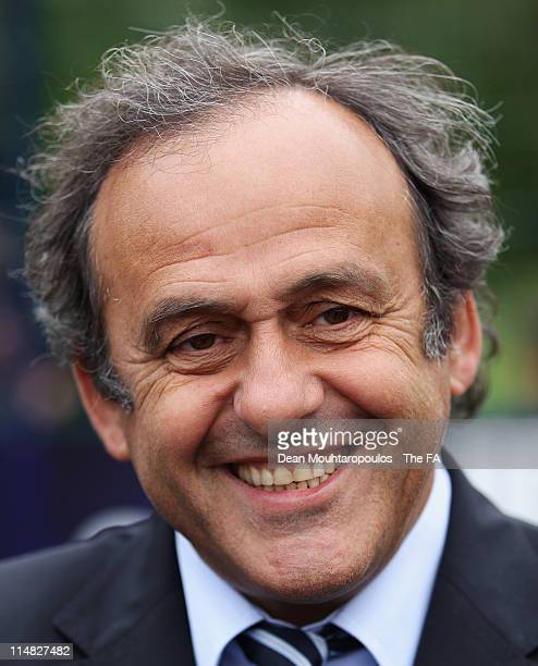 President Michel Platini speaks to the media during the unveiling of a new UEFA sponsored pitch at St Gregory's Catholic Science College on May 27...