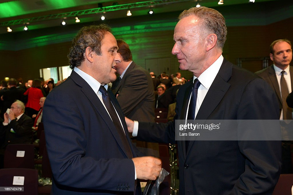 UEFA president <a gi-track='captionPersonalityLinkClicked' href=/galleries/search?phrase=Michel+Platini&family=editorial&specificpeople=206862 ng-click='$event.stopPropagation()'>Michel Platini</a> talks to FC Bayern Muenchen chairman <a gi-track='captionPersonalityLinkClicked' href=/galleries/search?phrase=Karl-Heinz+Rummenigge&family=editorial&specificpeople=634867 ng-click='$event.stopPropagation()'>Karl-Heinz Rummenigge</a> during the DFB Bundestag at the NCC Nuremberg on October 24, 2013 in Nuremberg, Germany.