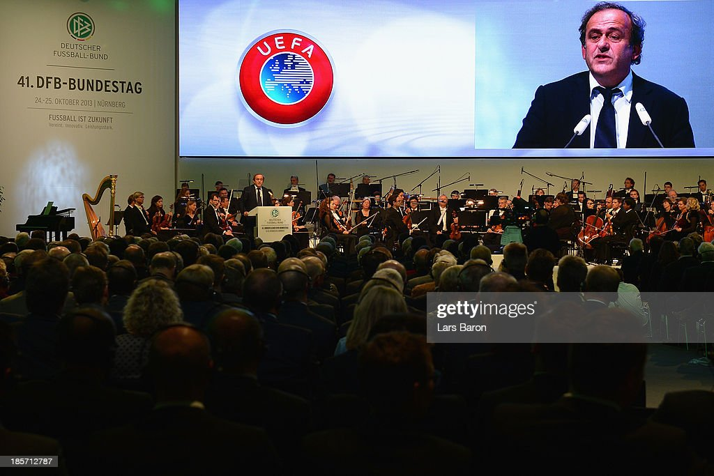 UEFA president <a gi-track='captionPersonalityLinkClicked' href=/galleries/search?phrase=Michel+Platini&family=editorial&specificpeople=206862 ng-click='$event.stopPropagation()'>Michel Platini</a> talks to the audience during the DFB Bundestag at the NCC Nuremberg on October 24, 2013 in Nuremberg, Germany.